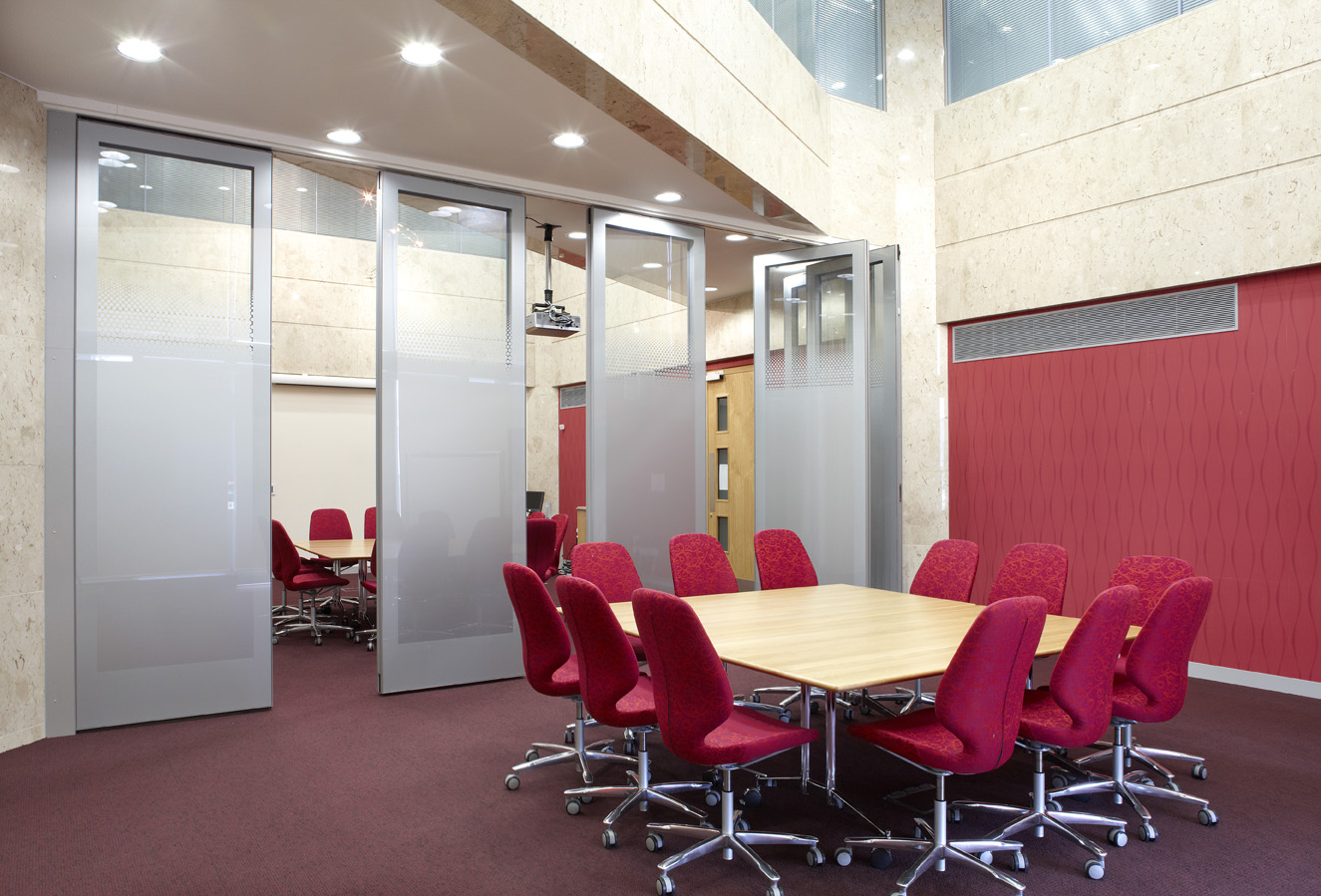 Seperated meeting rooms with glass partitioned walls