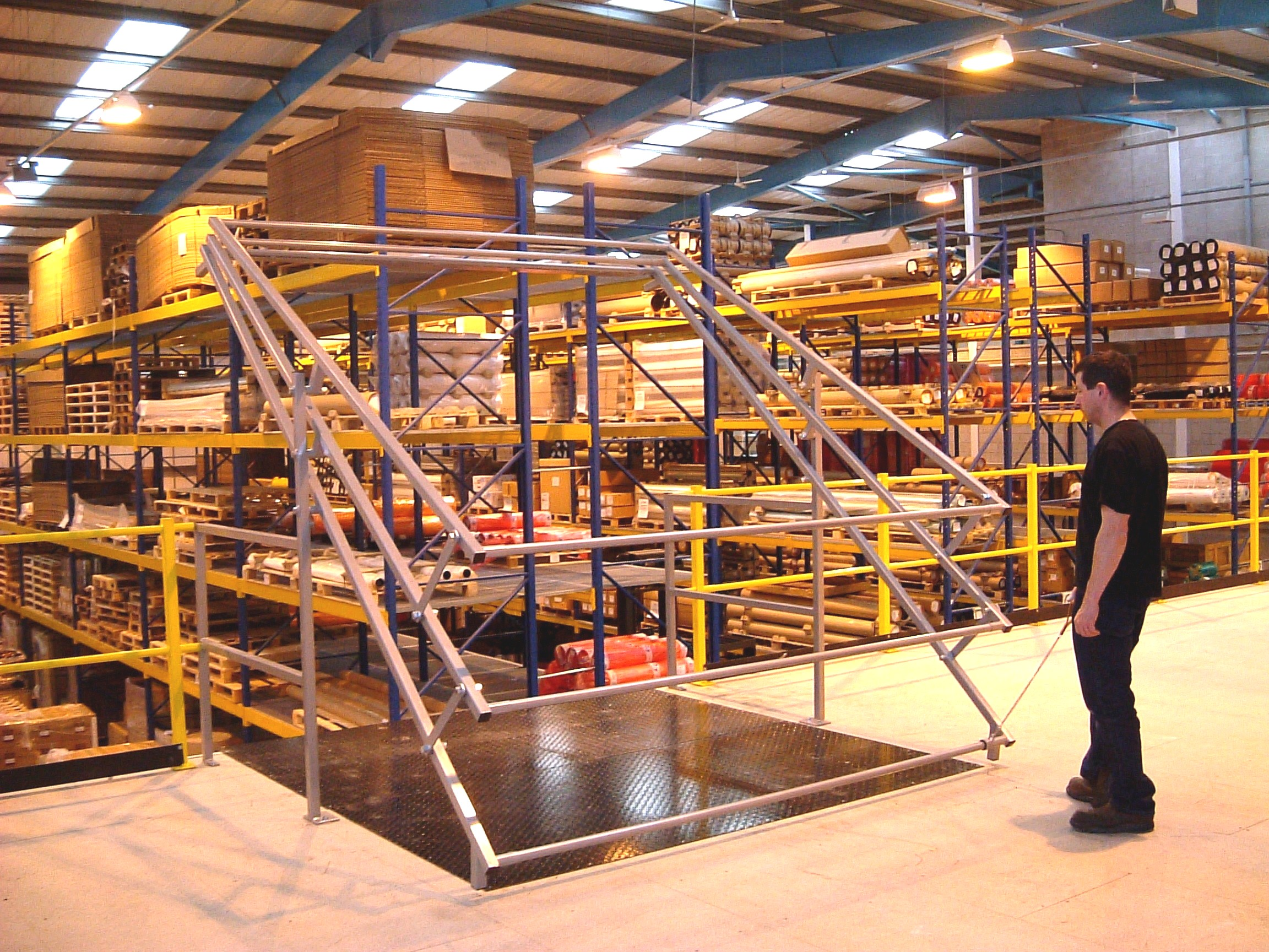 Mezzanine flooring lift addition