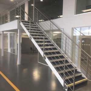 Installed staircase leading to mezzanine platform